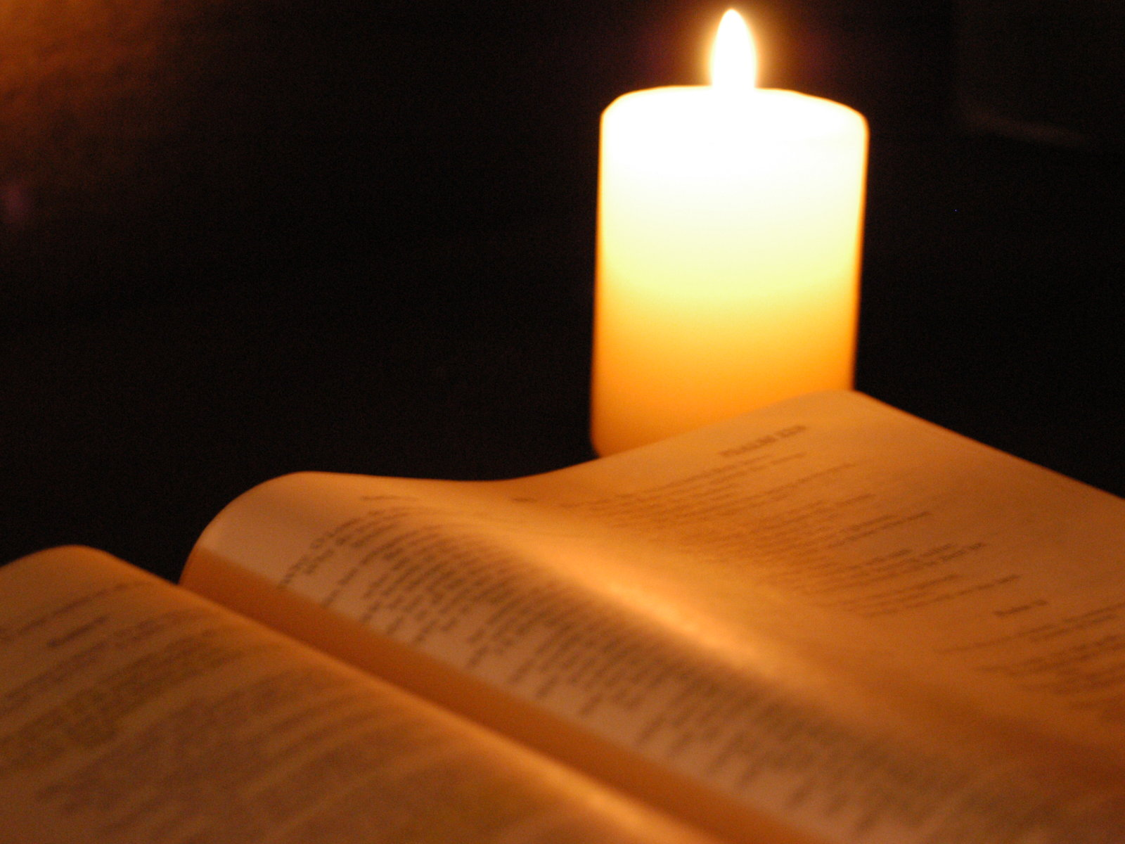 Holy Bible with Candle