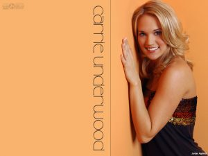 Christian Singer: Carrie Underwood on Orange Wall Wallpaper