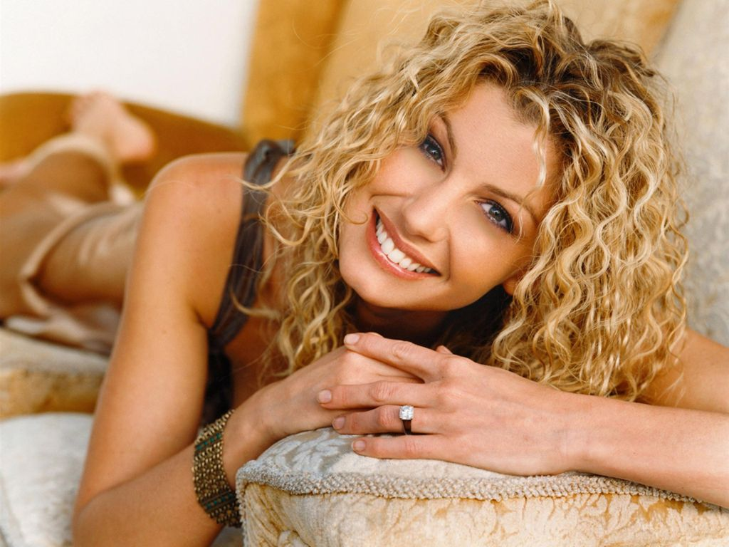 Christian Singer: Faith Hill Lying On Sofa christian wallpaper free download. Use on PC, Mac, Android, iPhone or any device you like.