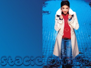 Christian Singer: Stacie Orrico Standing On Blue Background Wallpaper